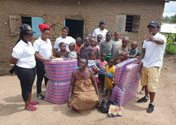 Muzee Home Care foundation members pose for a picture with one of the beneficiaries  of the project. (PHOTO/Courtesy)