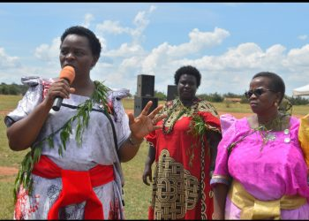 Ms Paece Mutuzo, the state minister fr gender addresses the Sabiny cultural day celebrations in Kween accompanied by commissioner ministry of gender and Ms Beatrice Chelangat, The REACH programme head. (PHOTO/David Mafabi)