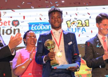 Allan Okello poses with his accolade after he was named FUFA Player of the Year on Saturday. (PHOTO/Courtesy)