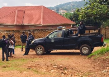 Police patrol parked at the road leading at Hon Betty Nambooze's home blocking some of the reporters from accessing her home