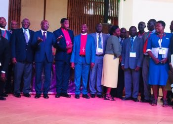 PS Education and Sports Mr Alex Kakooza, Archbishop of the Church of Uganda the Most Rt Rev Stanley Ntangali and UCU's Vice Chancellor Dr Rev Canon John Senyonyi taking a picture with the Head Teachers after the conference (PHOTO/Elizabeth Namajja)