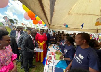 Vice President Ssekandi visors the UGANET stall during World AIDS Day. He is accompanied by Health Minister Dr Jane Ruth Aceng (far left) and the Minister for the Presidency Esther Mbayo. The two ministers will speak at the national dialogue (PHOTO/File)