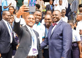 The Deputy Speaker, Jacob Oulanyah (centre) poses for pictures with students after the schools debate championship on Friday