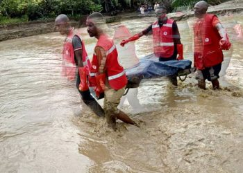 This photo tweeted by Red Cross Uganda on Decmber 8, 2019 shows their team carrying the body of one of the victims of Bundibugyo floods