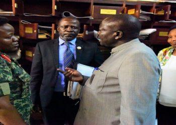 UPDF Rep Flavia Byekwaso interact with Hon. Anthony Okello, Hon. Godfrey Katusabe, after House adjourned prematurely (PHOTO/Courtesy)
