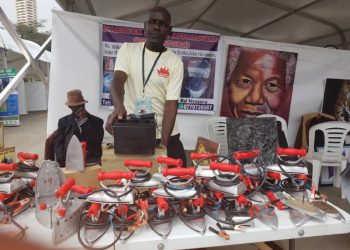 Moses Alyawo of Katosi-Mukono show cases solar flat irons at a recent Innovations Week expo. (PHOTO/File)