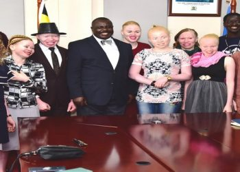 Deputy Speaker of Parliament, Jacob Oulanyah poses for a group photo with albinos recently (PHOTO/File).