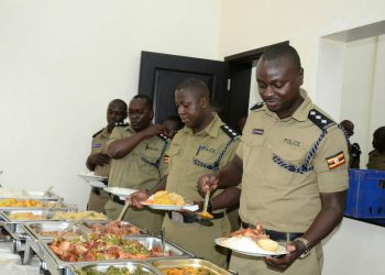 The police spokesperson Kampala Metropolitan, Luke Owoyesigyire fills plate to capacity (PHOTO/courtesy)