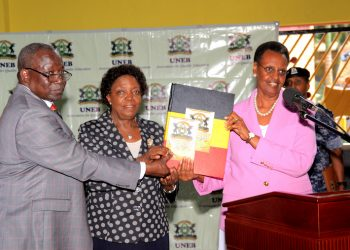 L-R The UNEB Executive secretary Mr Dan Odongo, UNEB Chairperson Prof. Mary Okwakol handing over the PLE Results of twenty nineteenn to the firstlady and minister of education Janet Kataha Museveni. PHOTO BY RACHEL MABALA