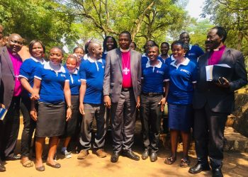 Chancellor of Uganda Christian University (UCU)  the Most Rt Rev Stanley Ntagali posing for a picture with the staff at UCU