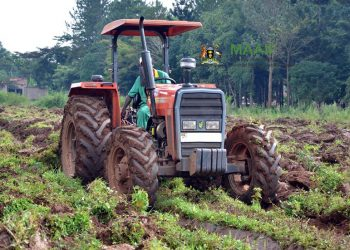 A tractor operator do plough the land