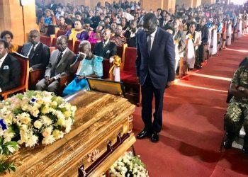 Dr Kiiza Besigye paying last respect to Prof Bwogi Richard at Namirembe Cathedral on Wednesday (PHOTO/Courtesy).