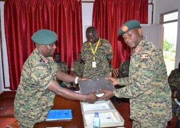 The incoming commander Brig Gen Julius  Biryabarema said that he was ready to learn from the experienced Div commander Maj Gen Samuel Kawagga (PHOTO/Courtesy)