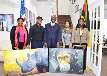 Uganda embassy officials in Washington DC parade charts of art on Friday (PHOTO/Courtesy).