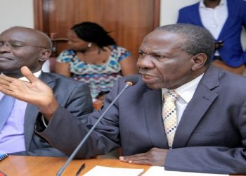 Finance Minister, Matia Kasaija(R) appears before the Committee with EC Chair, Justice Byabakama