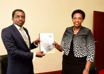 Outgoing PPS Molly Kamukama hands of reins to new PSS Omona at State House in Kampala (PHOTO/Courtesy)