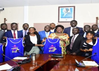 Speaker (C) with student leaders from UCU, Mukono (PHOTO/File)