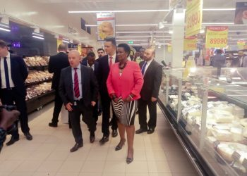 Minister Kyambadde and Carrefour bosses touring Supermarket at Oasis Mall on Tuesday