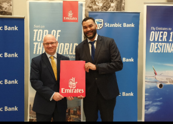 John Gemin (R), the Country Manager for Emirates in Uganda and Kevin Wingfield, the Executive Director Stanbic Bank Uganda officially unveil a promotion that will see the bank's Platinum Visa and Gold Credit Card holders receive special discounts on air tickets across Emirates First, Business and Economy class cabins (PHOTO/PML Daily)