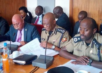 The Inspector General of Police (IGP) Martin Okoth Ochola (Centre) at the Defence Committee of Parliament