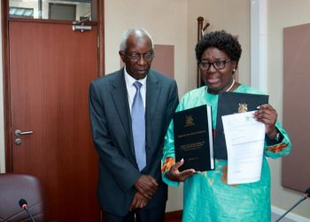 Auditor General John Muwanga hands over an audit report for the year 2019 to the Speaker of Parliament Rebecca Kadaga