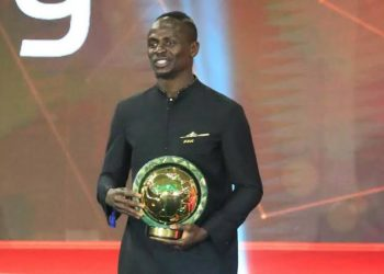 Mane holds his African Player of the year award on Tuesday night. (PHOTO/Courtesy)