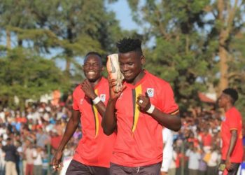 Joel Madondo (R) celebrates after scoring for Uganda at the recently concluded CECAFA Senior Challenge Cup in Kampala. (PHOTO/Courtesy)