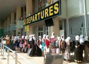 A group of Ugandans at Entebbe International Airport departures heading to the UAE for work. Government has suspended the suspended licensing and registration of new external labour recruitment companies amidst investigation to the staff of the Labour Ministry abusing the process (PHOTO/File)