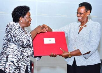 UNEB chairperson, Mary Okwakor (left) hands over the results booklet to the Minister of Education and sports, Janet Museveni during the release of Uganda Certificate Examinations 2018 (PHOTO/File)