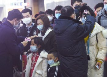 China has locked down some cities, including Wuhan, to try to contain a fast-spreading virus. WSJ's Shan Li took one of the last trains out of the outbreak epicenter as millions adjusted travel plans for the Lunar New Year holiday.