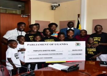Speaker of Parliament Rebecca Kadaga handing over one hundred fourteen millions two hundred fifty thousand to the triplets ghetto kids at parliament to cater for their residence on 18th february, 2020._7364