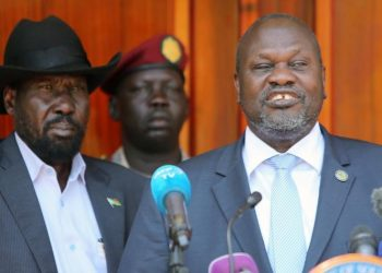 South Sudan's ex-vice President and former rebel leader Riek Machar flanked by President Salva Kiir Mayardit address a news conference at the State House in Juba, South Sudan February 20, 2020.