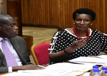 Hon Kyambadde (R) with State Minister for Industry, Hon Michael Werikhe appearing before the Committee on Trade