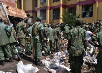UPDF officers doing a voluntary cleaning in Jinja town on Monday (PHOTO/Courtesy).