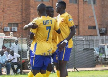 KCCA FC players celebrate Hebert Achai (C) goal at Lugogo on Tuesday. (PHOTO/Courtesy)