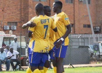 KCCA FC players celebrate Hebert Achai (C) goal at Lugogo on Tuesday. (PHOTO/Courtesy)