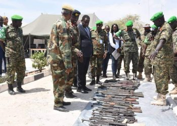 AMISOM officers parade weapons recovered in Somalia on Thursday (PHOTO/Courtesy).