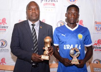 Sam Simbwa (L) and Cromwel Rwothomio (R) pose with their accolades at Kati Kati Restaurant on Monday. (PHOTO/Courtesy)