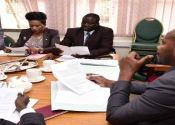 Hon Ndeezi (R) in a meeting with offcials of the Federation of Uganda Employers