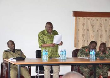 Mr. Moses Kizige, Minister of State for Karamoja Affairs address a consultative meeting on the security situation in Karamoja (PHOTO/Courtesy)