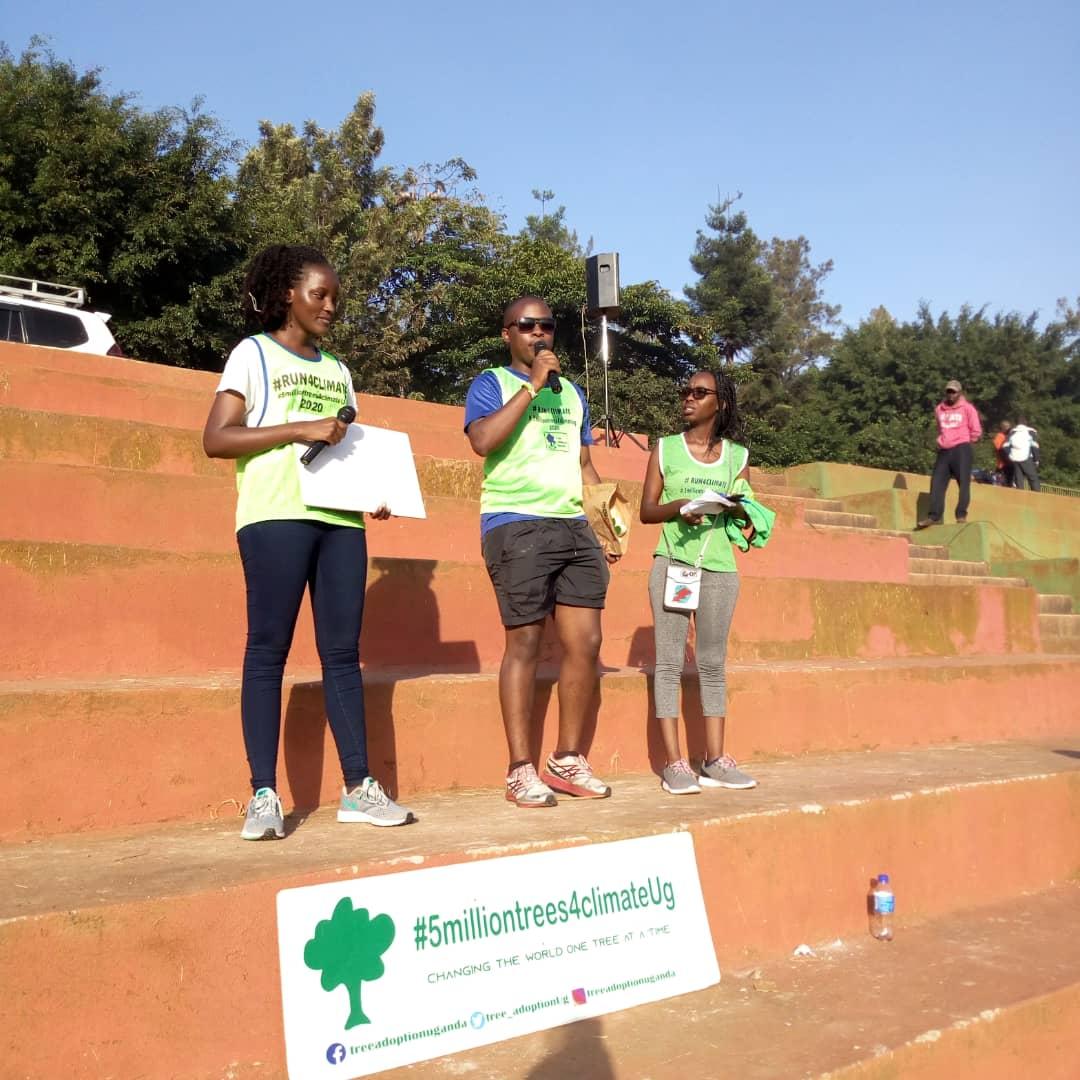 ( L - R)  Ms. Vanessa Nakate a environment Activist who flagged the run as one of the Tree Adoption Uganda stafff gives  instructions and Rita Mahooro ( Abraham)