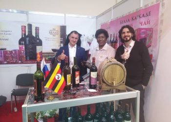 Ms. Prudence Ukkonika  Busingye  in the center the proprietor of Bella Wine under K- Roma displaying her products in company of some clients at the Prod Expo in  Moscow, Russia.