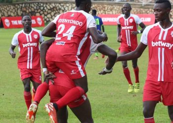 Express FC players celebrate one of their two goals against Tooro United FC at Kavumba on Wednesday. (PHOTO/COURTESY)