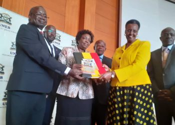 UNEB chairperson Mary Okwakol (2nd-L) and executive secretary Dan Nkorach Odongo (2nd-R) present the 2019 UACE exam results to education and sports minister Janet Museveni for official release (PHOTO/File)