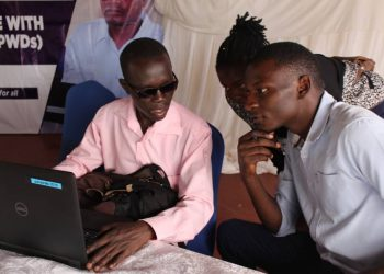 The blind computer expert Denis Komakech and Javira Ssebwami at Greens Garden Hotel in Mbale last week. (PHOTO/PML Daily)