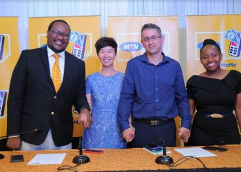 The various representatives after launching the money remittance platform between MTN and Vodacom custiomers in Uganda and Tanzania (PHOTO/Abraham Mutalyebwa)