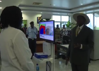 President Kaguta Museveni undergoing screening at Entebbe airport on arrival from Luanda, Angola (PHOTO/Screen grab)