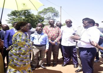Speaker of Parliament Rebecca Kadaga interacting with officials of the world bank after touring the proposed site for construction of the Kamuli market (PHOTO/PML Daily)