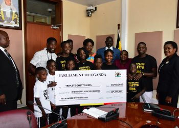 Speaker Rebecca Kadaga handing over one hundred fourteen millions two hundred fifty thousand to the triplets ghetto kids at parliament to cater for their residence on 18th February 2020 (PHOTO/Courtesy).