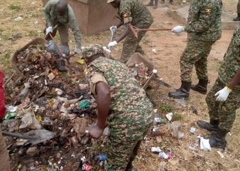 UPDF officers doing voluntary cleaning in Arua Municipality (PHOTO/Courtesy).